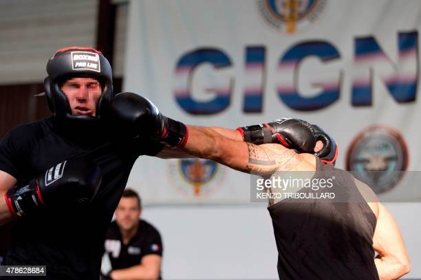 Two French gendarmes trying out for the National Gendarmerie Intervention Group pass an aggression test with a boxing bout on the last day of...