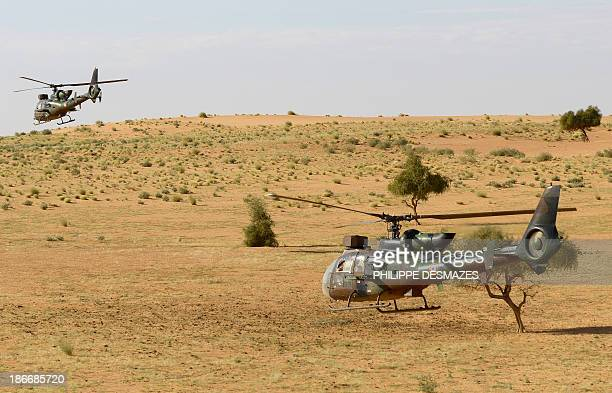 Two French helicopters Gazelle fligh over the desert during the Operation Hydra on October 29 near the village of Bamba between Timbuktu and Gao in...