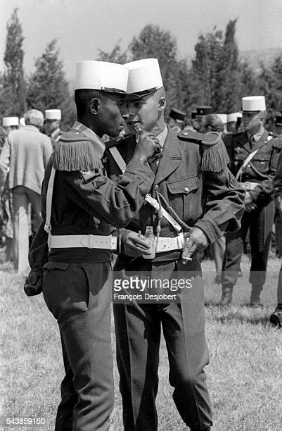 Two French Legionnaires chat during a celebration in Calvi Corsica The barracks at Calvi are open to the public as the French Foreign Legion...