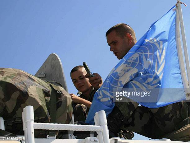 Two French soldiers with the United Nations Interim Force in Lebanon sit atop their armoured vehicle in the southern Lebanese town of Marjayoun 15...