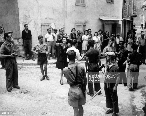 Two French spies denying charges of having acted as informers for Nazi Gestapo to a crowd of hostile onlookers in a French village