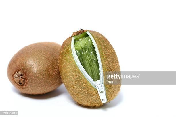 Two fresh kiwi with zip ( copy space)