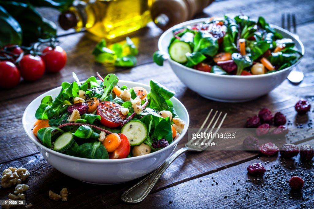 Two fresh salad bowls : Stock Photo