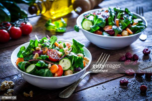 two fresh salad bowls - salad stock pictures, royalty-free photos & images