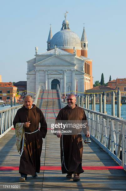Two friars walk on the votive bridge ahead of the opening for the Redentore Celebrations on July 20 2013 in Venice Italy Redentore is one of the most...