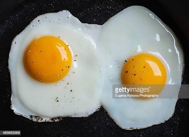 two fried eggs - fried eggs stock pictures, royalty-free photos & images