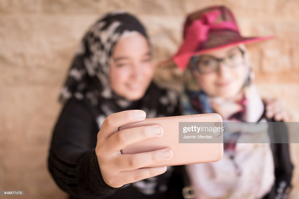 Two friendly girls making selfie : Stock Photo
