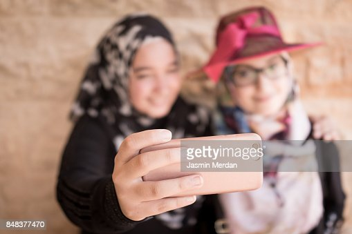 Two friendly girls making selfie