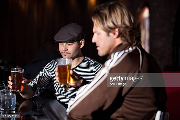 Two friends at a bar