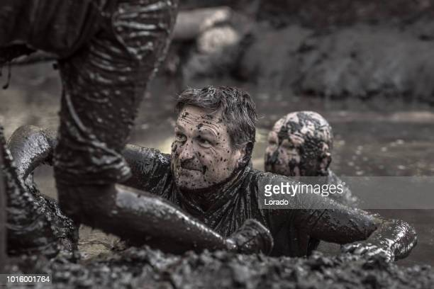 two friends at a mud run - military training stock pictures, royalty-free photos & images