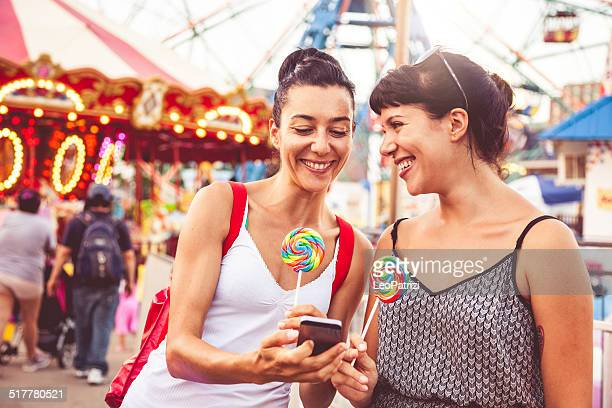 two friends at amusement park - coney island stock pictures, royalty-free photos & images