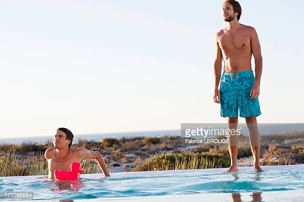 Two friends at swimming pool