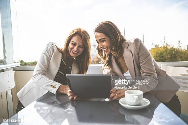 two friends at the cafè - women - clip stock pictures, royalty-free photos & images