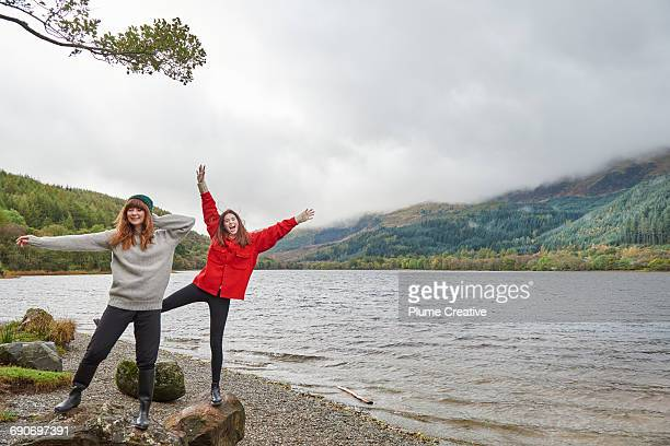 Two friends being silly by a loch