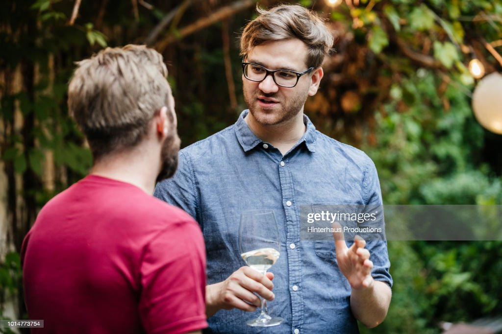 Two Friends Chatting And Drinking At BBQ : Stock Photo