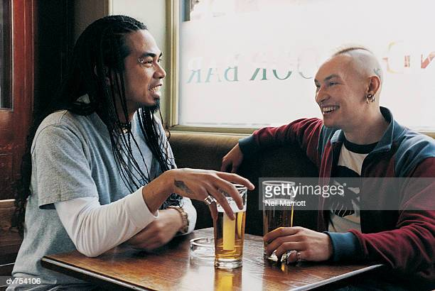 Two Friends Chatting in the Pub