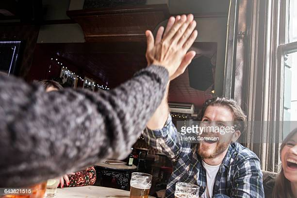Two friends doing a high five