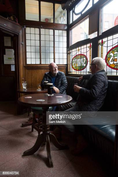 Two friends drink Guinness at O'Neill's traditional Irish Pub on 04th April 2017 in Dublin, Republic of Ireland. Dublin is the largest city and...