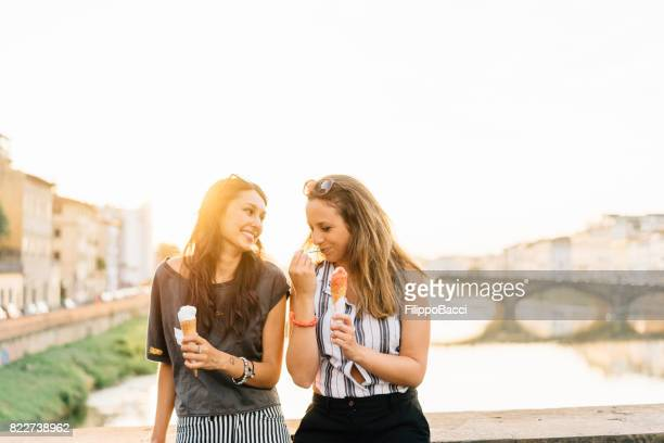 Two friends eating ice-cream together
