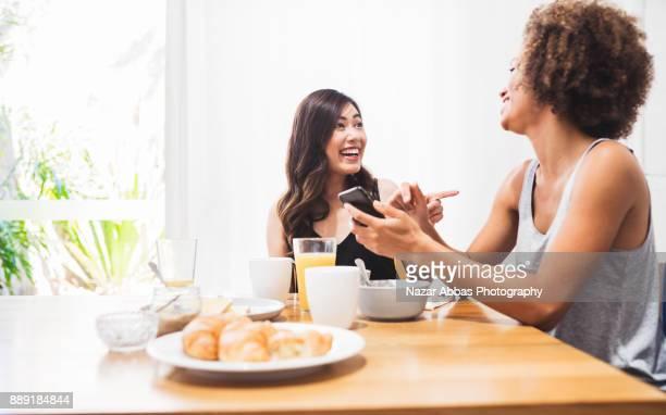 Two friends enjoying breakfast together.