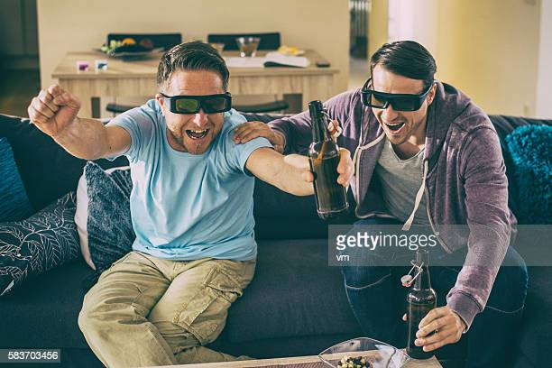 Two friends excited watching a 3D movie