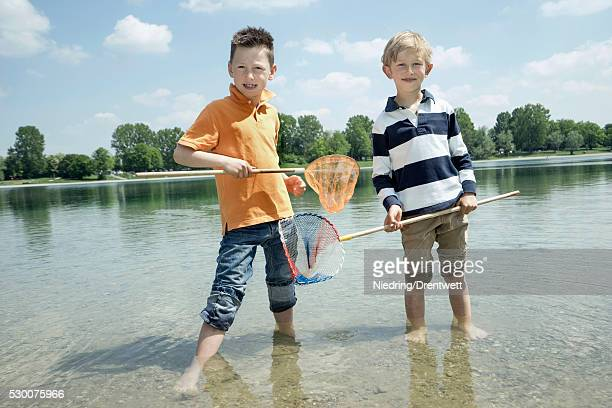 Two friends fishing in the lake, Bavaria, Germany