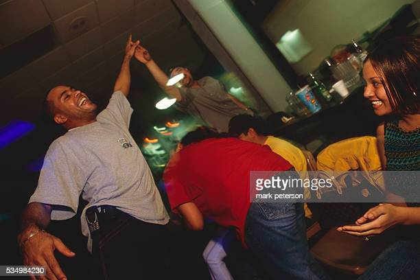 Two friends give each other a high five at Extreme Bowling in Alexandria Virginia