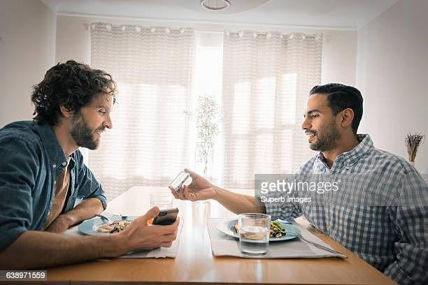 Two friends have a meal from a personal perspectiv