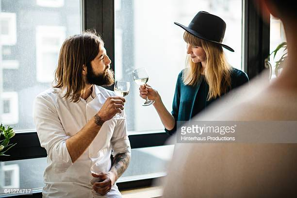 two friends having a drink together - flirtare foto e immagini stock