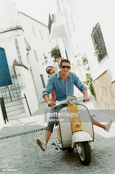 Two Friends having Fun on a Motor Scooter
