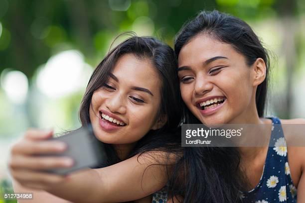 Two friends having fun taking a selfie