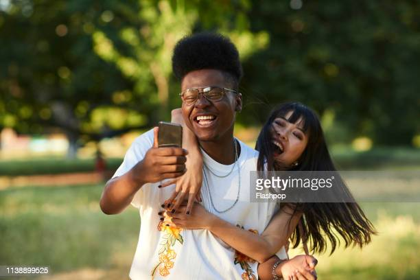 two friends having fun taking a selfie with smart phone - funny stock pictures, royalty-free photos & images