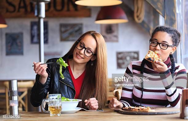 Two friends having lunch in restaurant