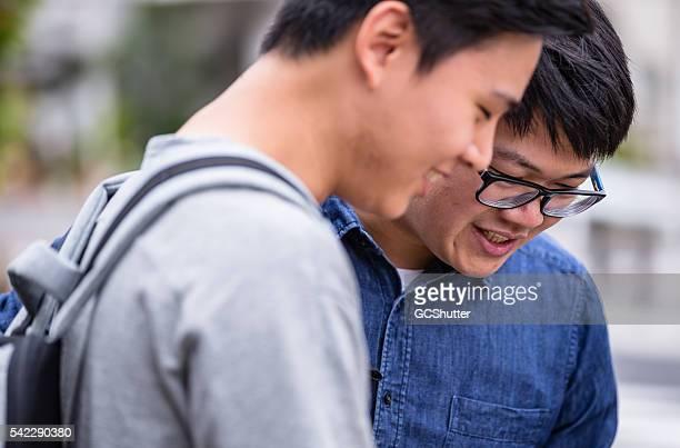 Two Friends having secretive chat