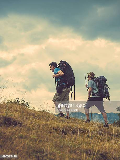 two friends hiking on hill