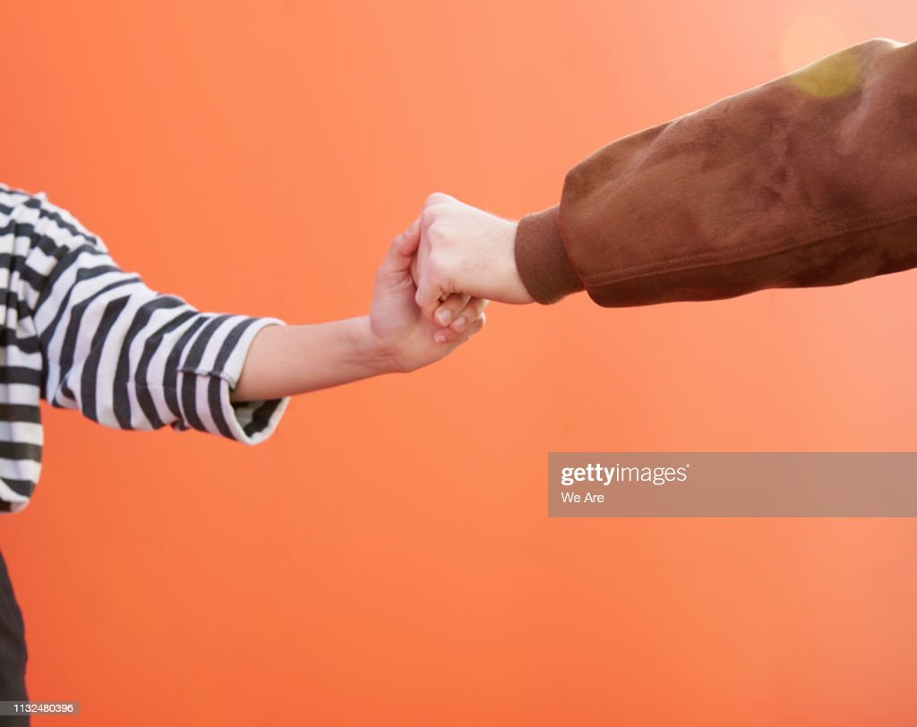 Two friends holding hands. : Stock Photo