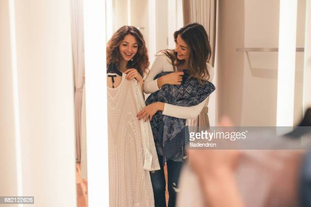 two friends in a dressing room - dressing room stock pictures, royalty-free photos & images