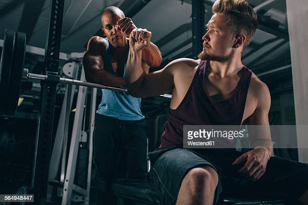 Two friends in a gym