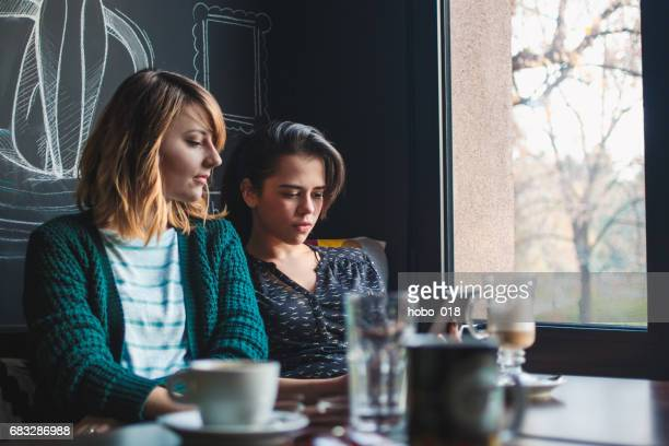 two friends in cafe - lesbian dating stock pictures, royalty-free photos & images