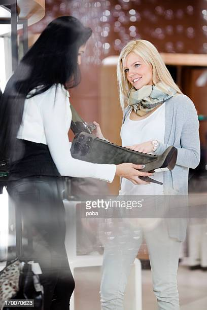 two  friends  in department store looking at new shoes - adults only stock pictures, royalty-free photos & images