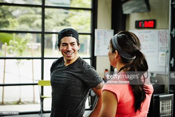 Two friends in smiling in Gym gym