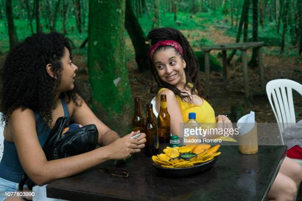 two friends in the nature enjoying and drinking beer - cali colombia stock pictures, royalty-free photos & images