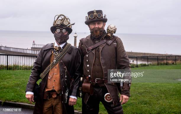 Two friends in traditional Goth costumes at the Whitby Goth Weekend Festival in Whitby in North Yorkshire.