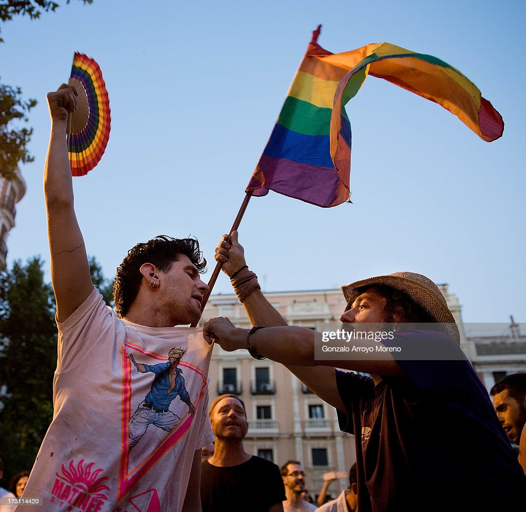 Two friends joke and dance during a performance of The Rocky Horror Picture show at King Square in the Chueca neighborhood during the Madrid Gay Pride Festival 2013 on July 7, 2013 in Madrid, Spain. According to a new Pew Research Center survey about homosexual acceptance around the world, Spain tops gay-friendly countries with an 88 percent acceptance rate.