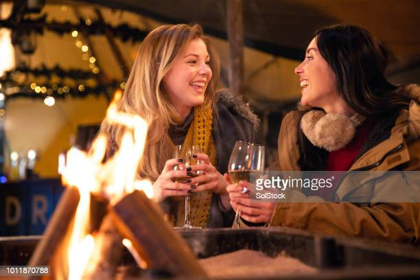 two friends laughing together - fire pit stock pictures, royalty-free photos & images