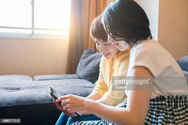 Two friends looking at a digital tablet