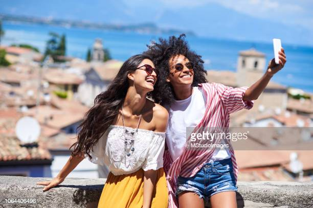 two friends making a selfie. - brazil vs argentina stock photos and pictures
