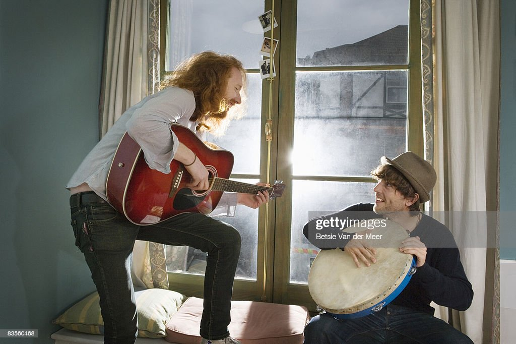 Two friends making music. : Stock Photo