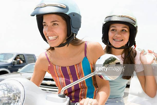 Two friends on a scooter