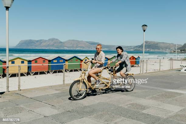 Two friends on a tandem bicycle